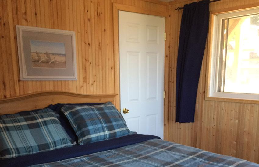 beachfront cottage bedroom with queen bed